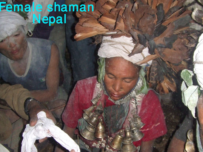 Female shaman in Nepal hanging bells on her neck.